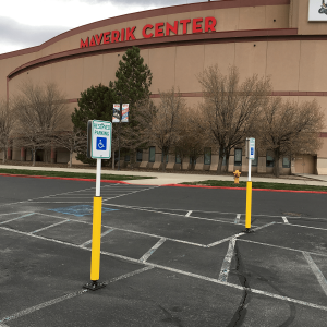 """Impact Recovery Systems Sta-Rite 78"""" Sign Post With Bollard in Parking Lot with Parking Sign"""