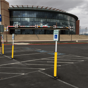 """Impact Recovery Systems Sta-Rite 102"""" Sign Post With Bollard In Parking Lot with Parking Sign"""