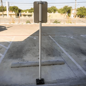 """Impact Recovery Systems Sta-Rite 102"""" Sign Post Without Bollard In Parking Lot"""