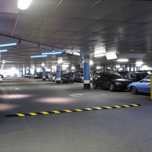 NoTrax® 4' EasyRider Recycled Rubber Speed Bump In Parking Garage